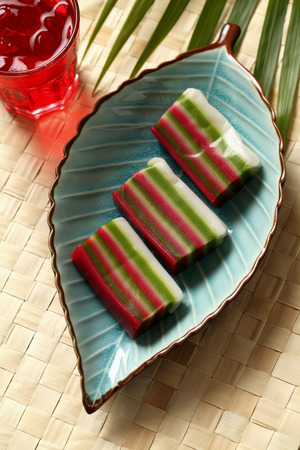 Nine layer cake (Kueh) on leaf plate. Traditional Malay dessert