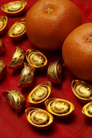 Chinese gold ingot and oranges