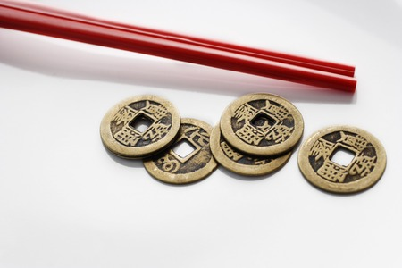 Chinese coins with red chopsticks LANG_EVOIMAGES
