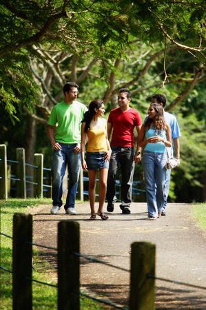Group of young adults walking in park