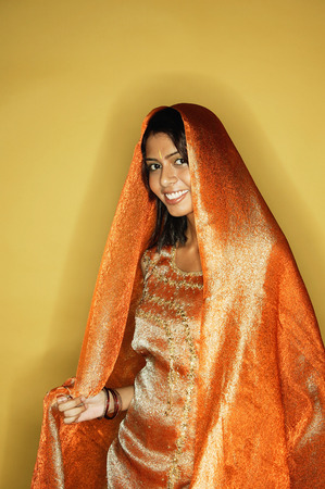 Woman in Indian clothing, scarf draped on head
