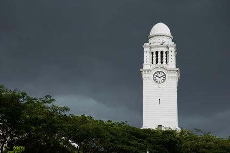 Clock tower against dark skies