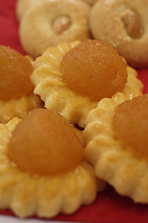 Still life of pineapple tarts and cashew nut cookies