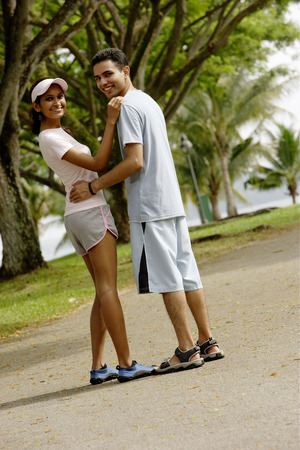 over the shoulder: Couple standing, looking over shoulder