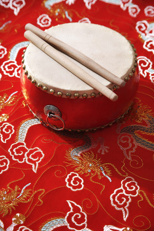 Still life of Chinese drum on Chinese silk fabric