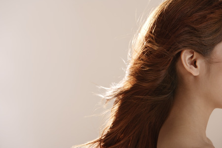 Profile shot of young womans hair