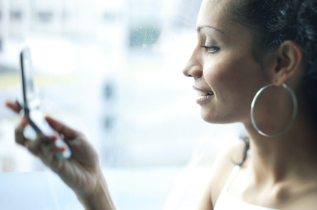 woman profile: Woman holding mobile phone, profile