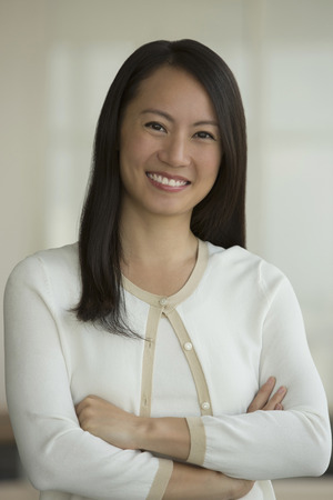 Singapore, Portrait of business woman in office Imagens