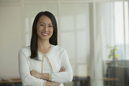 Singapore, Portrait of business woman in office Stock Photo