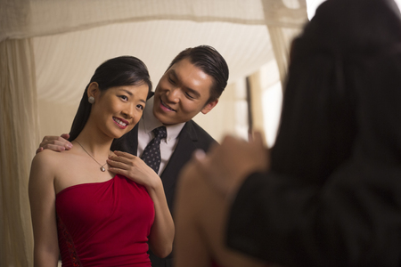 evening wear: Singapore, Reflection of couple in evening wear in mirror