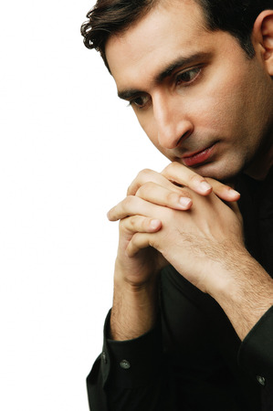Executive resting head on clasped hands, looking down Stock Photo - 69408230