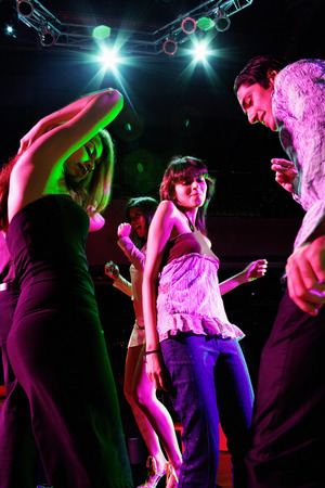 adults: Young adults dancing in club LANG_EVOIMAGES