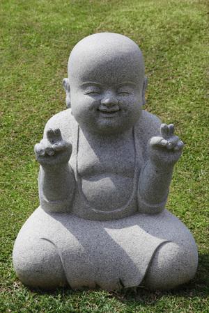 Stone statue of happy Buddha