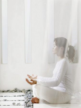 dhyana: woman meditating, resting LANG_EVOIMAGES