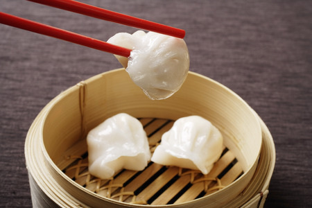 red chopsticks holding dim sum Stock Photo