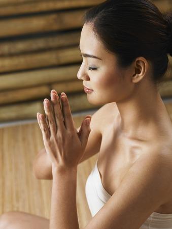 woman profile: profile shot of woman meditating LANG_EVOIMAGES