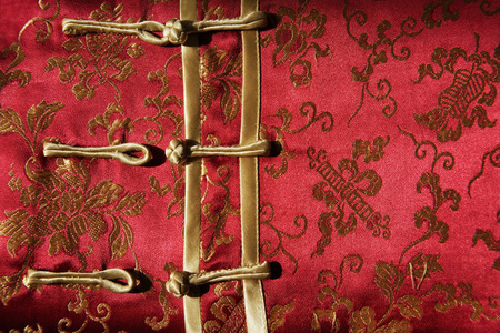Detail of buttons on silk Chinese shirt Imagens - 69409161