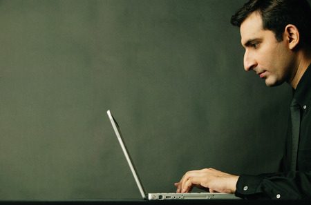 profile: Man using laptop, profile