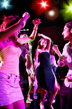 adults: Young adults in club, dancing