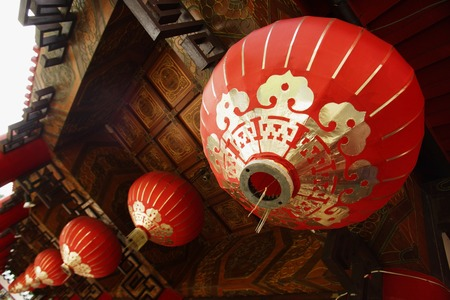 red lanterns hanging from temple roof