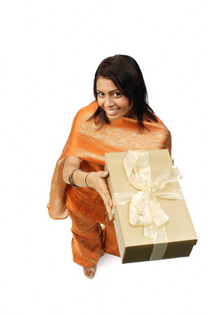 Woman in Indian clothing, holding gift box