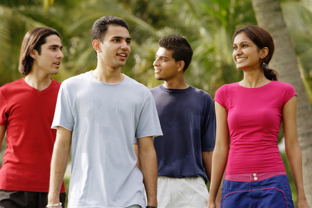 adults: Young adults walking in park
