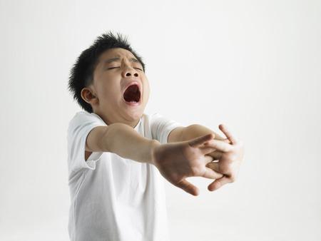 tiredness: boy yawning LANG_EVOIMAGES