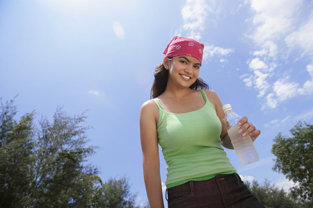 isolation tank: Young woman with bandana smiling at camera LANG_EVOIMAGES