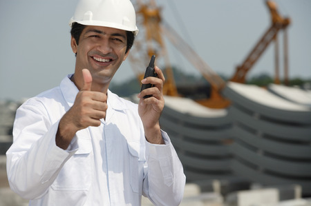 Man in work uniform gives thumb up Imagens - 69409862