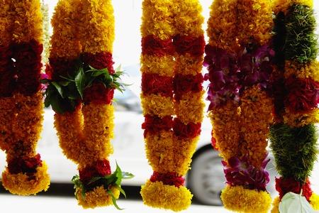 Brightly coloured flower garlands Фото со стока - 69409909