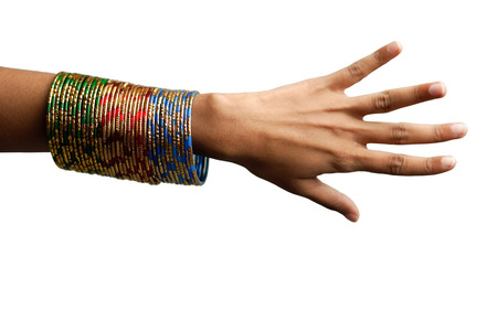 womans hand: Womans hand with many bangles on her wrist LANG_EVOIMAGES
