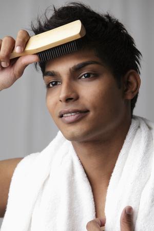 young man brushing his hair Stock fotó