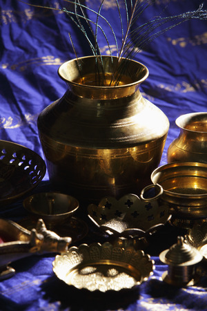 Still life of Indian bronze bowls and plates