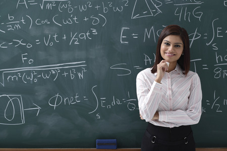 formulae: Woman standing proudly in front of chalk board