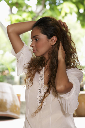 woman profile: Profile of young woman holding hair LANG_EVOIMAGES