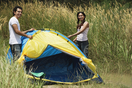 Young couple camping in high grass