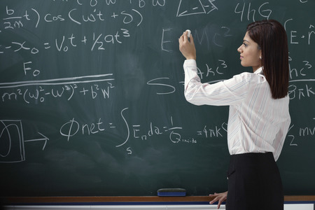 writing western: Woman writing equations on chalk board