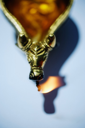 Still life of oil lamp with animal detailing Banco de Imagens