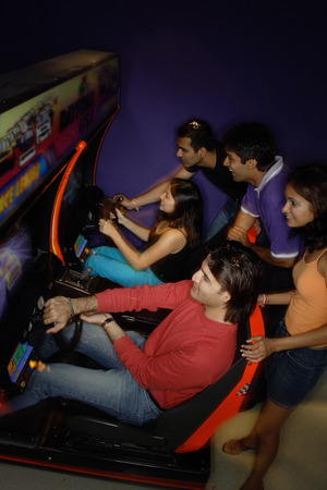 adults: Young adults in amusement arcade