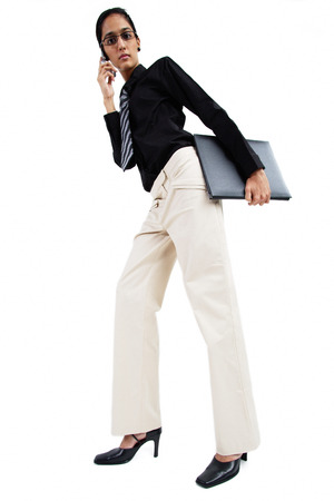Business woman using mobile phone, low angle view LANG_EVOIMAGES
