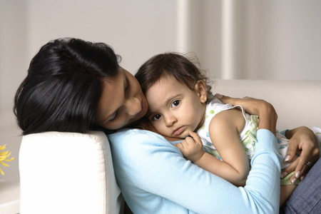 cradling: woman cradling baby
