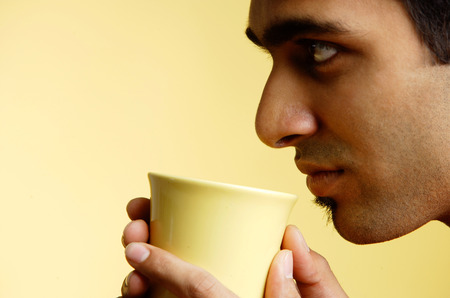profile: Man holding mug , profile