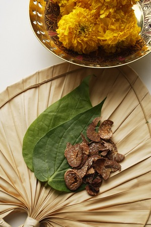betel nut and leaves with chrysanthemums top view Stock Photo