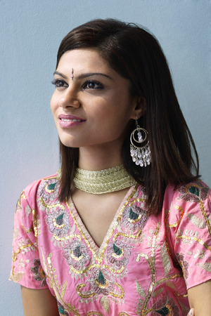 Young woman dressed in traditional Indian clothing (salwar kameez)