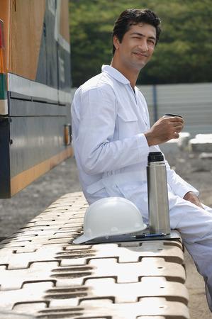 Man in work uniform taking a break