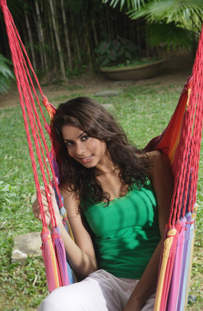 Woman in hammock, looking at camera