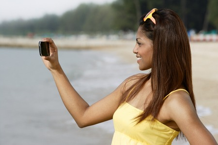 Side view of woman taking a picture Stock Photo