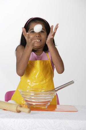 tossing: Girl baking, tossing egg