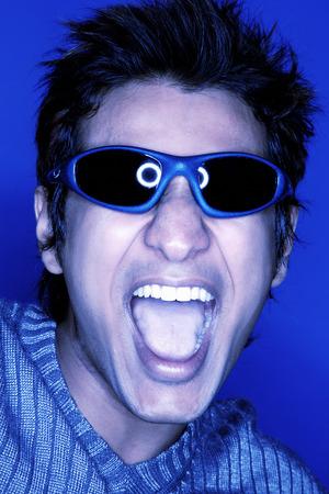 Man wearing sunglasses, shouting, tinted image