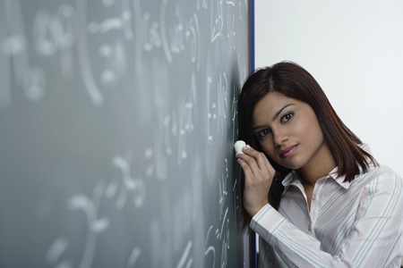 Tired teacher at chalk board Stock Photo